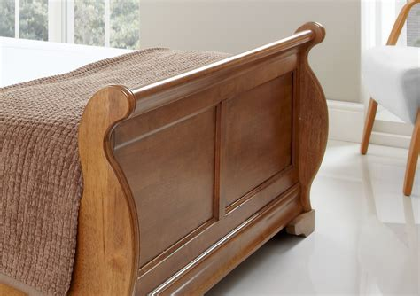 wooden sleigh bed louie wooden sleigh bed oak finish light wood wooden