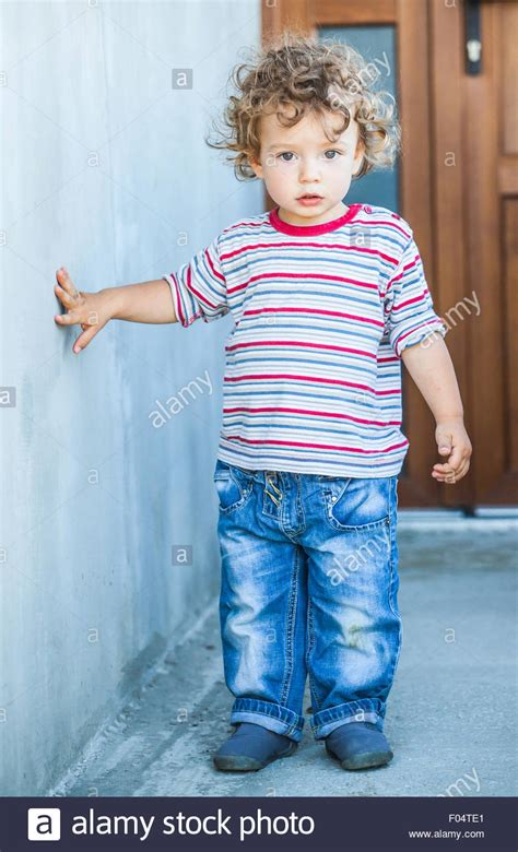 one year old baby boy portrait stock photo thinkstock portrait of 1 year old baby boy walking outside the house
