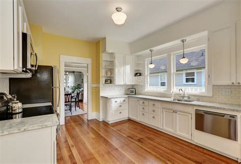 pale yellow walls white cabinets wood counter tops kitchen interior with white cabinets yellow walls and