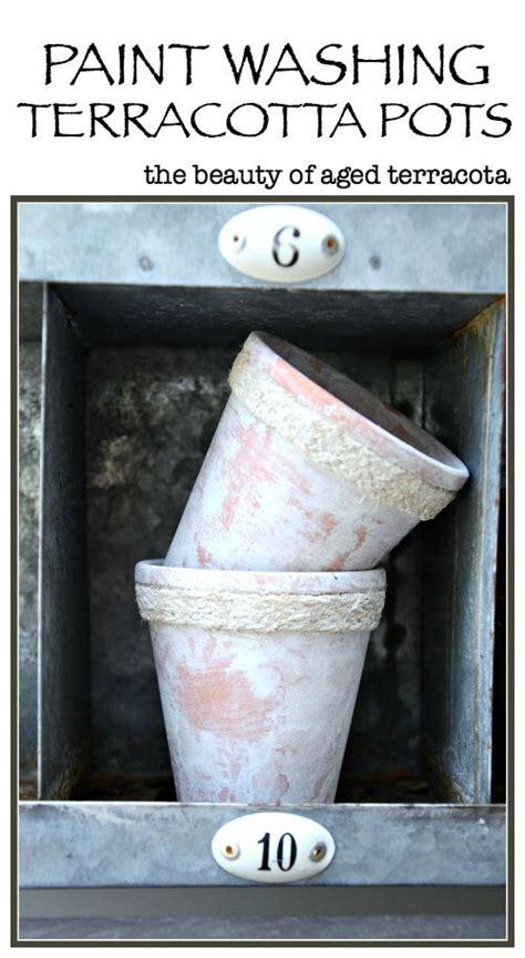 paint washing terracotta pots stonegable