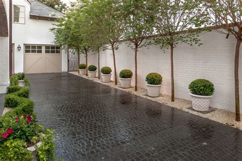 driveway pavers landscape traditional with european landscaping crape myrtles