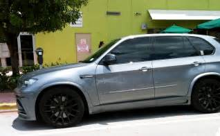 gray bmw x5 m with black rims cars on the streets