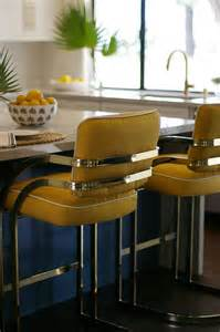 blue gray kitchen island with brass t pulls