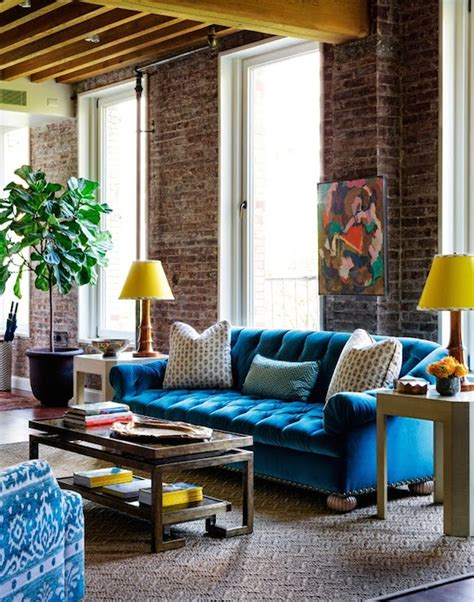 blue and yellow sofa turquoise tufted sofa eclectic living room tilton