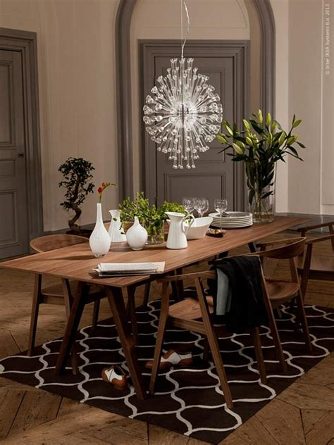 walnut veneer stockholm table and chairs with chandelier