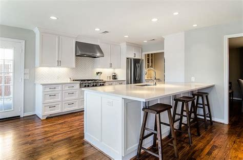 Delightful Kitchen Cabinets That Sit On Countertop #7: Kitchen-peninsula-white-quartz-countertop-dark-sawhorse-stools.jpg