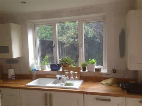 tile 2 kitchen walls around work surfaces and window