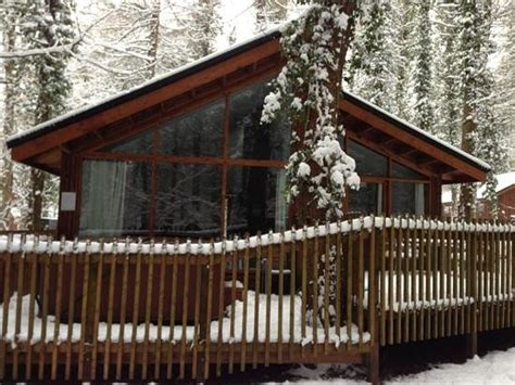snowy cabin picture of forest holidays forest of