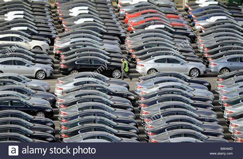 jaguar cars castle bromwich address a worker walks amongst brand new jaguar cars at the car