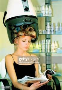 ladaires de salon mid with rollers in hair a hair dryer stock photo getty images