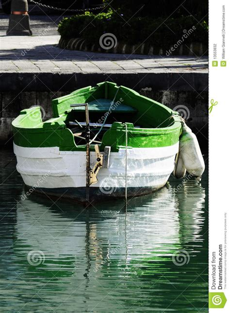 green boat cleaner a red boat in green clear clean water lake in switzerland