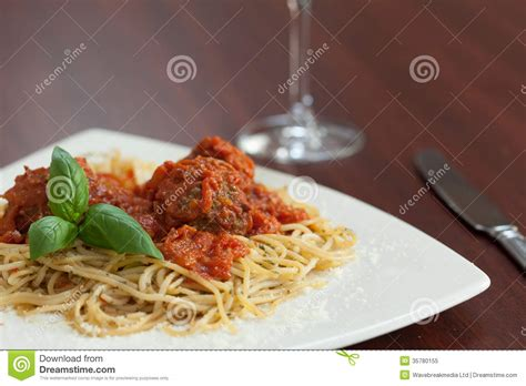 red wine with spaghetti and meatballs close up of spaghetti and meatballs with red wine royalty