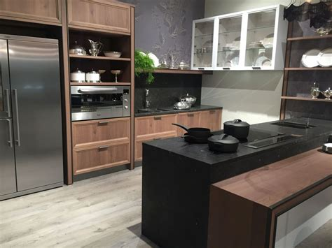 Black And Brown Kitchen Cabinets by Keep Up With The Waterfall Countertop Trend Looks That
