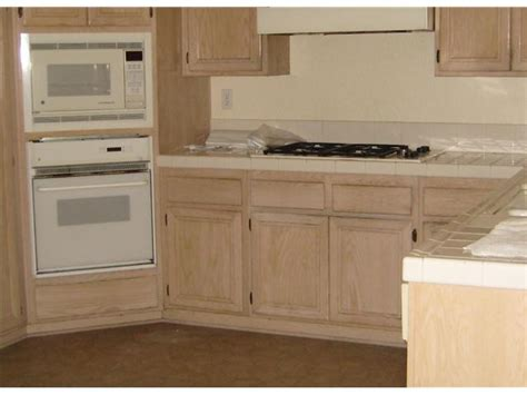 can i stain my kitchen cabinets how to stain wood cabinets in kitchen