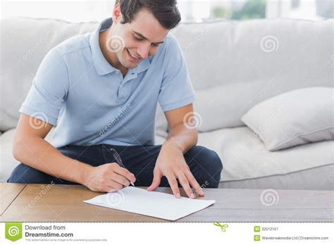 person writing on paper person writing on paper www pixshark images