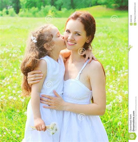 mother s mother s day and happy family concept child kissing