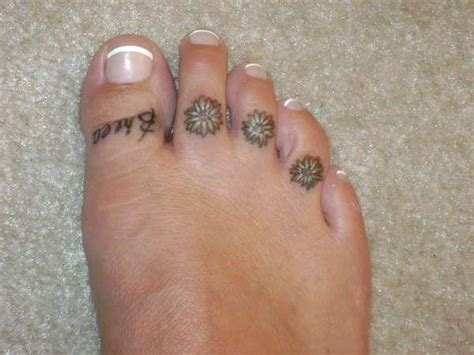 small toe tattoos 18 beautiful flower toe tattoos