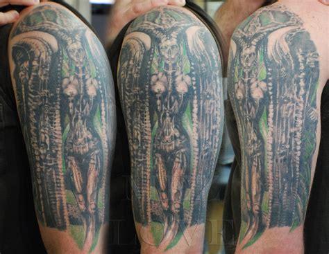 hr giger tattoo designs stylish biomechanical giger on biceps tattooshunt