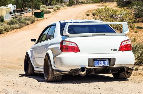 subaru impreza modified 2007 subaru impreza wrx sti rear view dusty road