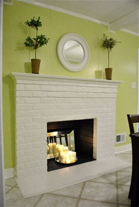 fireplaces candles and mirror on