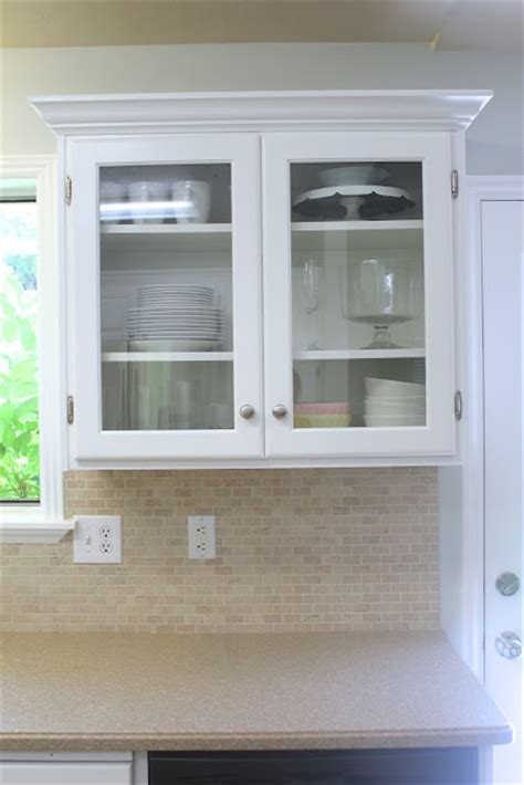putting glass in kitchen cabinet doors remodelaholic big kitchen makeover on a little budget