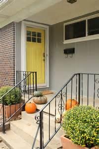 gray house yellow door yellow door rosemary on the tv