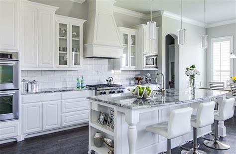white kitchen cabinets with white countertops white and gray granite countertops