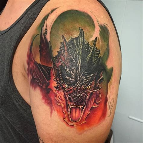 smaug tattoo tattooing by daniel brockett progress on a smaug half