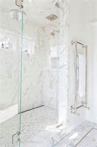 exquisite master shower is clad in white marble subway