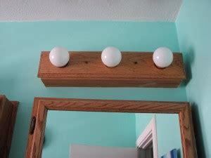 wood bathroom light fixtures wooden fluorescent light fixture light fixtures design ideas