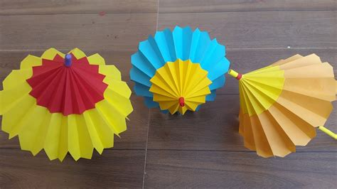 How To Make Paper Umbrella - how to make a paper umbrella that open and closes step by