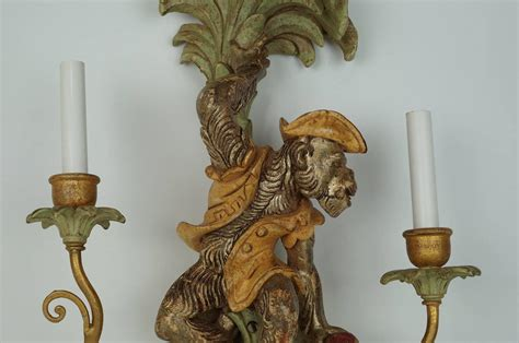 Monkey Sconce pair of two arm wall light sconces with monkey figures for sale at 1stdibs
