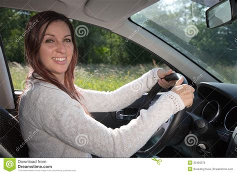 woman driver on the phone for car breakdown woman driver on the phone for car breakdown woman driver