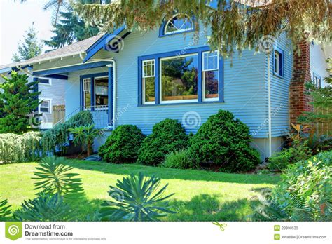 blue craftsman house blue old craftsman style house behind the tree stock photo