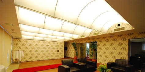 Stretched Ceiling System by Backlit Wall Panels