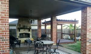 covered patio with outdoor fireplace and pergola