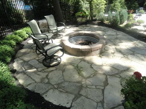 Tumbled Paver Fire Pit Blends In Great With This Flagstone Pit On Patio Pavers