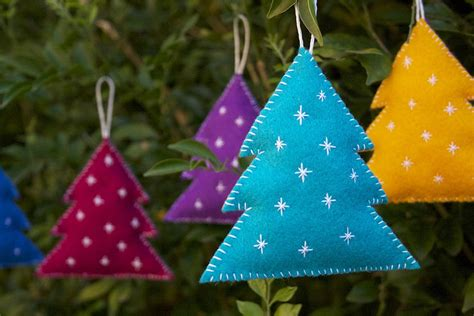 colorful tree ornaments and cuddly felt trees and other ornaments