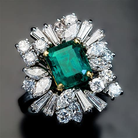 vintage asymmetrical design emerald engagement