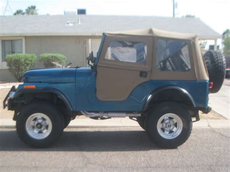 black and teal jeep seller of cars 1971 jeep cj teal green and