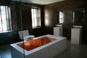 copper tub in a high end bathroom decoist