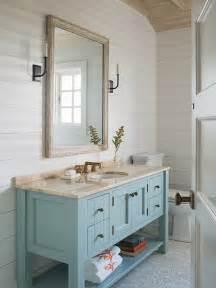 Whitewashed mirror cottage bathroom