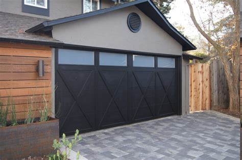 Elegant House With Black Garage Doors Camer Design Black Garage Door