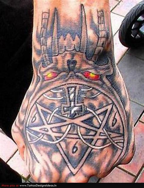 Evil Tattoo On Hand | ink bone rad hand tattoos