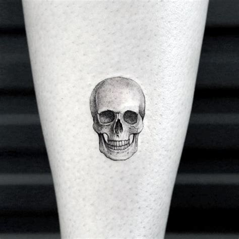 50 small skull tattoos for men mortality design ideas