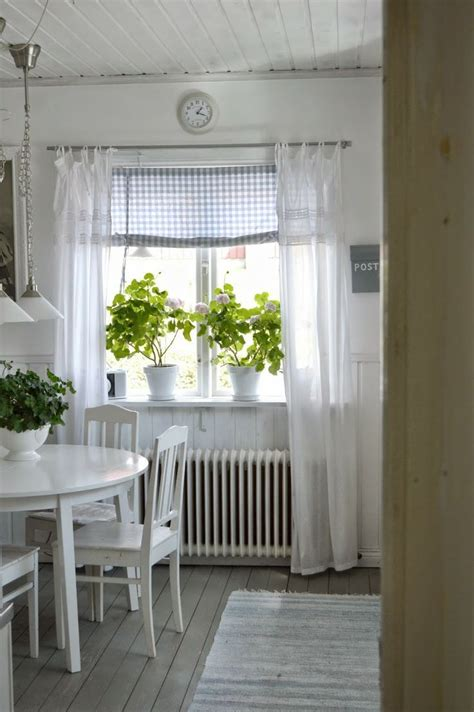 swedish farmhouse style charming window dressing using cheer linen curtains