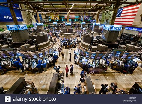 Stock Market Floor by Trade Floor Personnel On The Floor Of The New York Stock