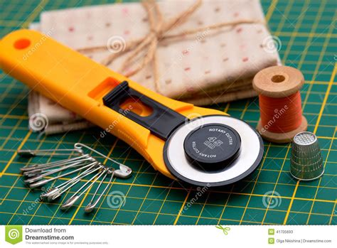 patchwork sewing tools on green mat stock photo image