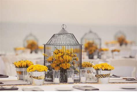 birdcage wedding centerpieces with yellow