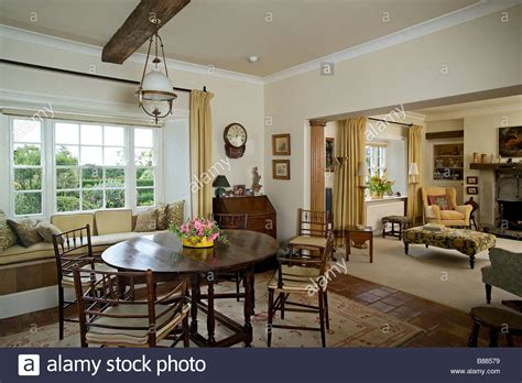 living room with dining table dining room with dining table and views through to